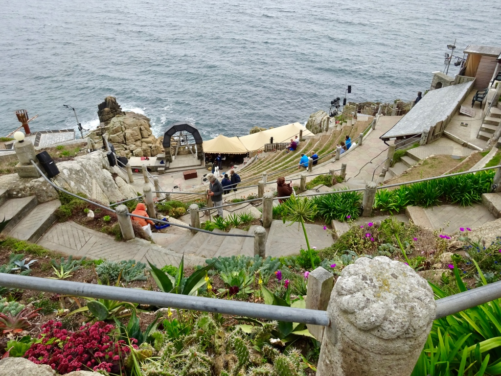 Minack theatre, Cornwall, England. Cliff side stone seats looking over the stage towards the sea.