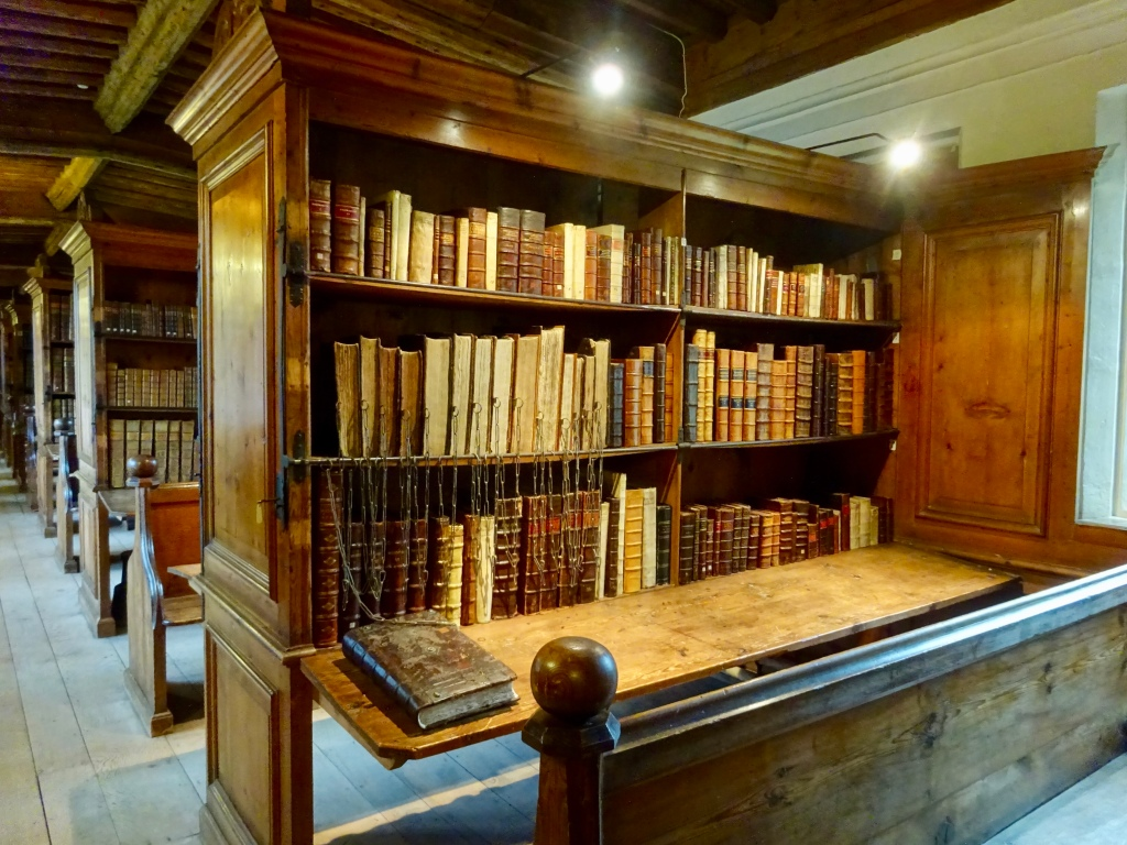 Bookshelf with 18th century books in Wells Cathedral Library, Wells, Somerset.